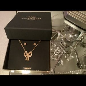 Beautiful coach gol filled necklace and earrings set